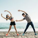 couple stretching at the beach 23 2147827065 150x150 - woman-in-sunglasses-enjoying-sun_23-2147848998