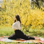 side view woman stretching her body while exercising park 1 150x150 -